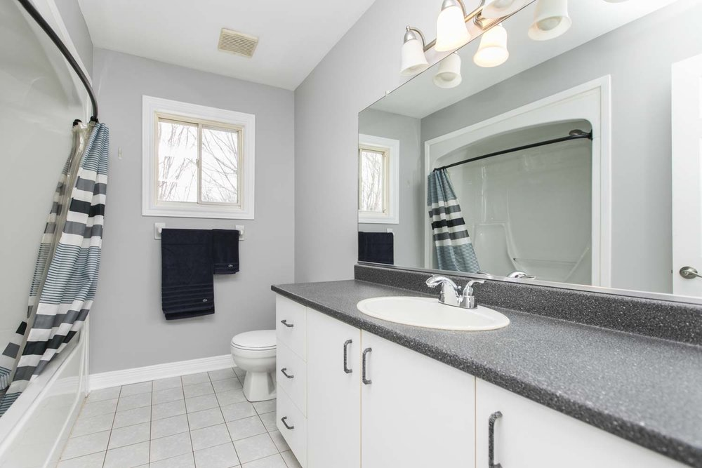 Great sized family bathroom with tile floor, clean tub insert and updated light fixture. Neutral colours, lots of storage and natural light illuminate this space.