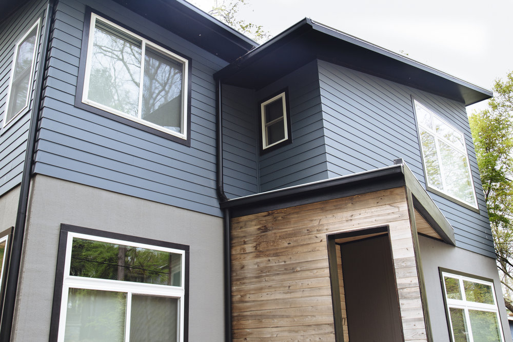 Blue Home with K-Style Gutters and Round Downspouts