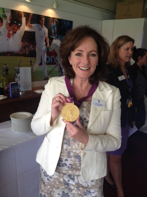 Jacquie Storey with an Olympic Gold Medal  - briefly borrwed from Peter Wilson. Pictured in the Chairman's box at Lords Cricket Ground