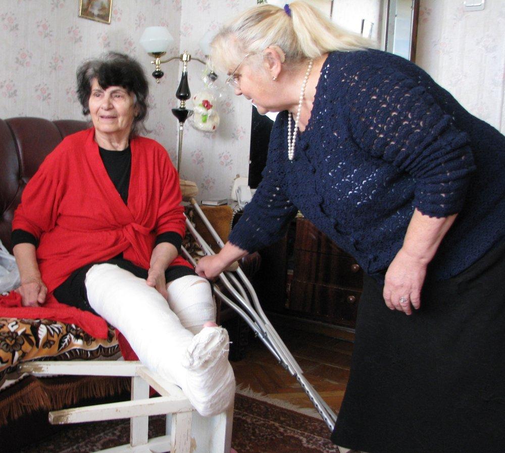 Zina helping a homebound widow.