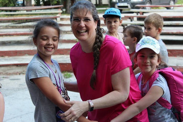 Kim with children at Summer Camp.jpg