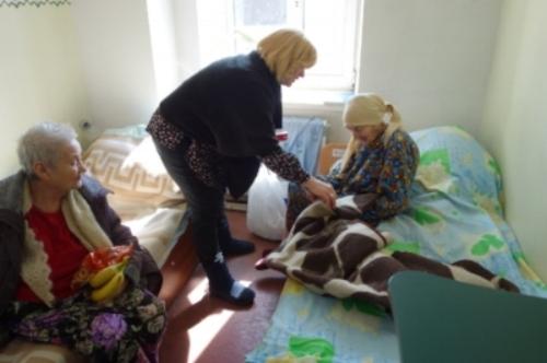 Ira visiting widows at nursing home in Eastern Ukraine.JPG