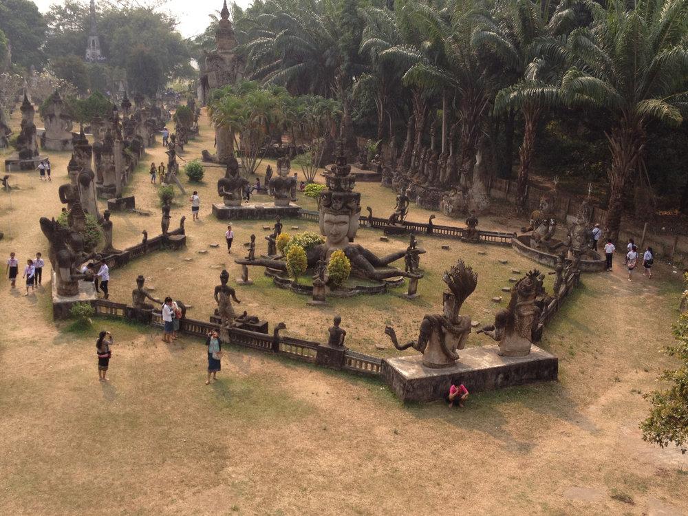"The Xieng Khuan (""buddha park"") is sculpture park that mixes Buddhist and Hindu statues"