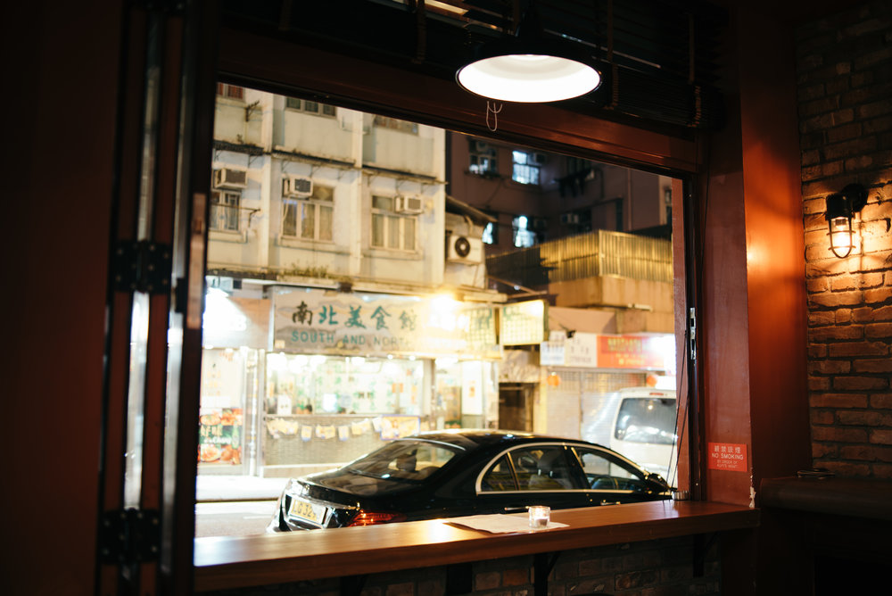 - The neighbourhood of Kennedy Town is an intruiging place for Alvy's to be located, as it's quite far from the traditional business and restaurant areas. It was important to highlight how the venue fit into the surrounding street, and how the windows link both worlds together.