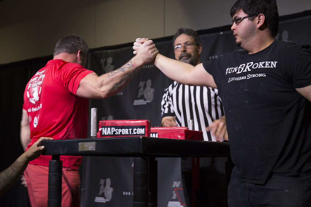 Will Dinwiddie (left) and Isaac Saeidi after their match at the 2017 US Armwrestling Open in Lincoln City.
