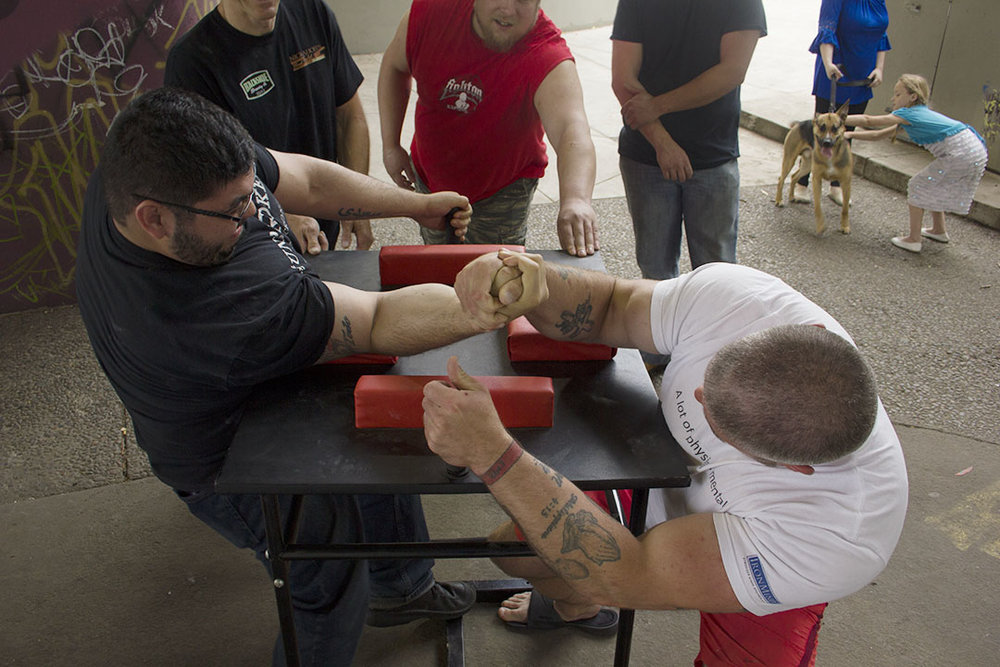 Isaac Saeidi (left) armwrestles Will Dinwiddie at a team practice in Eugene, OR.