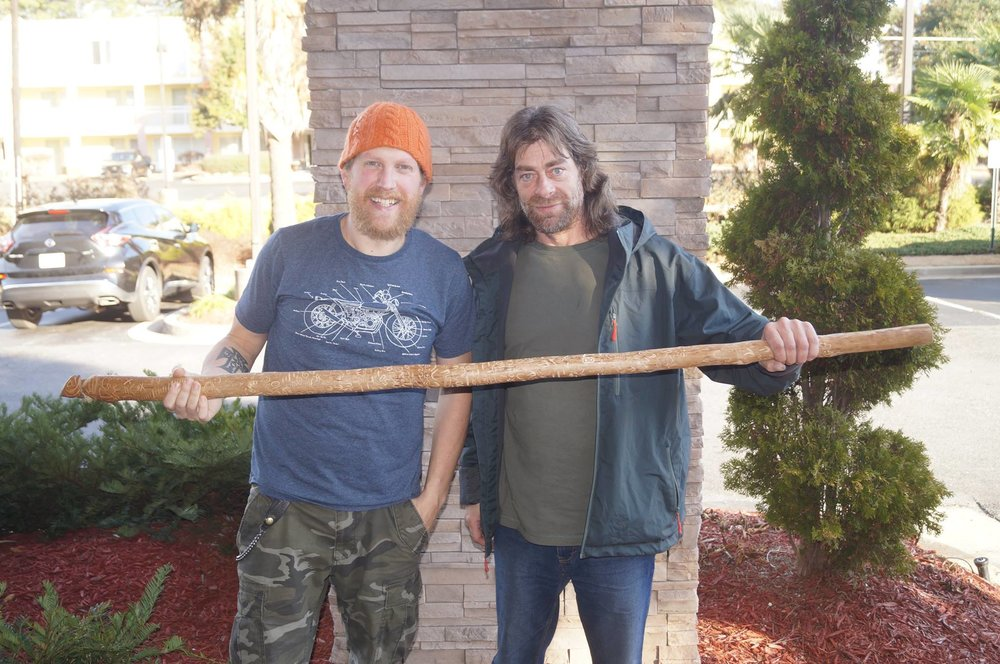 Greg and I holding my wizard staff that I carved in Patagonia.