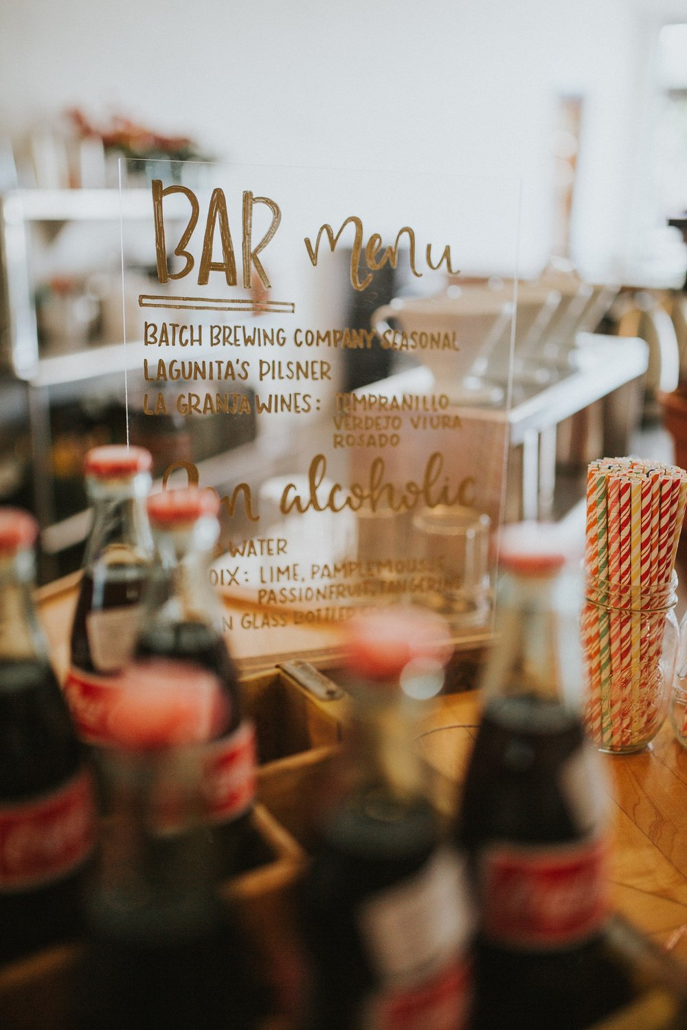 The bar was filled with vintage Mexican coke bottles, craft brews and Trinosophes' specialty coffee. Signage by  Mitten Script by Marah . Don't forget a straw!