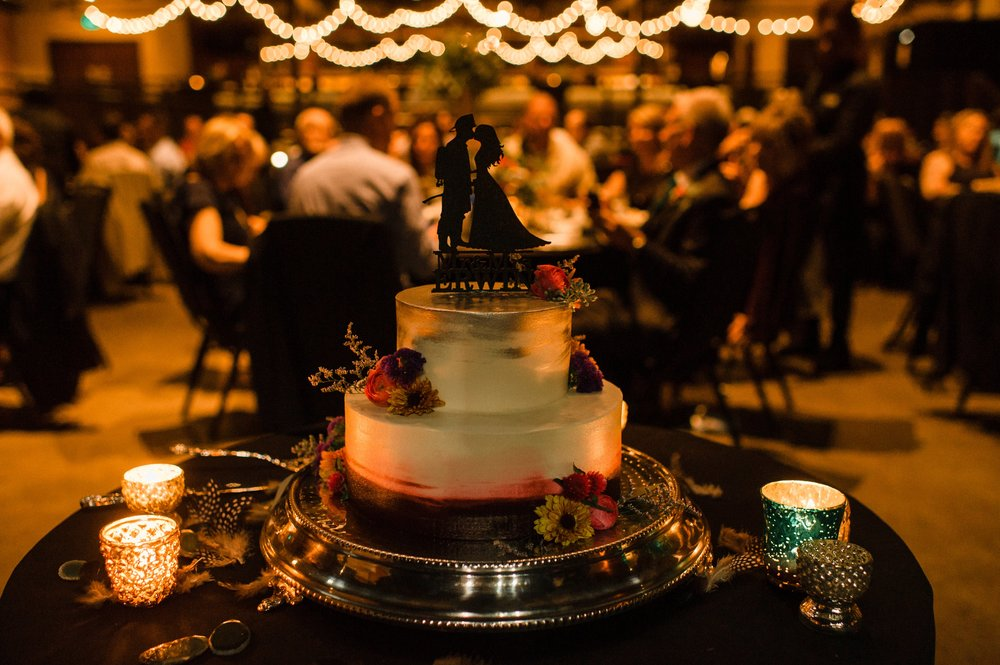 Holiday Market Royal Oak created a lovely cake with a purple smear on the bottom that matched their wedding look.