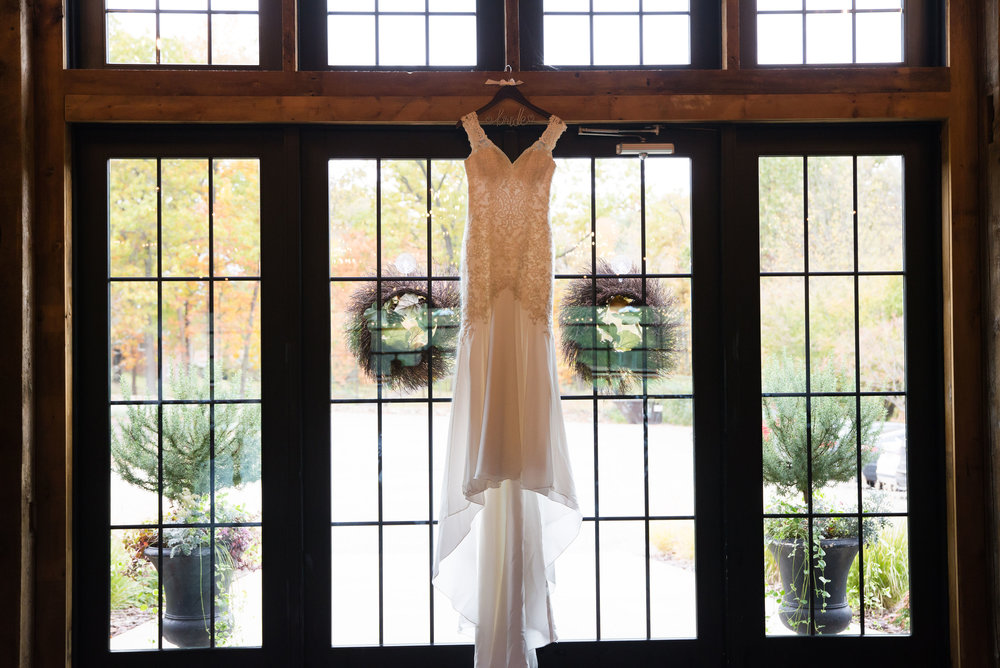 Black Barn's main entrance perfectly framed Katie's gorgeous wedding dress.