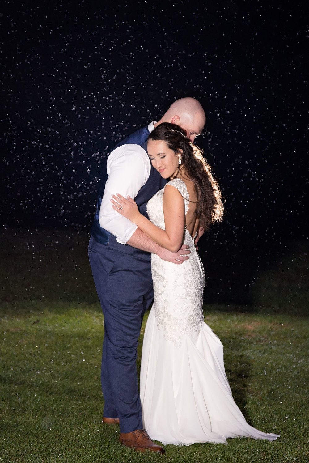 Nighttime rain photo magic by the amazing  Lindsey Anderson Photography .
