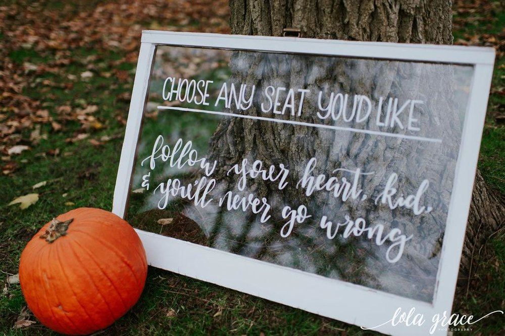 "Paul and Michelle wanted to include one of their favorite quotes from ""The Sandlot"" on their ceremony sign made by  Mitten Script by Marah ."