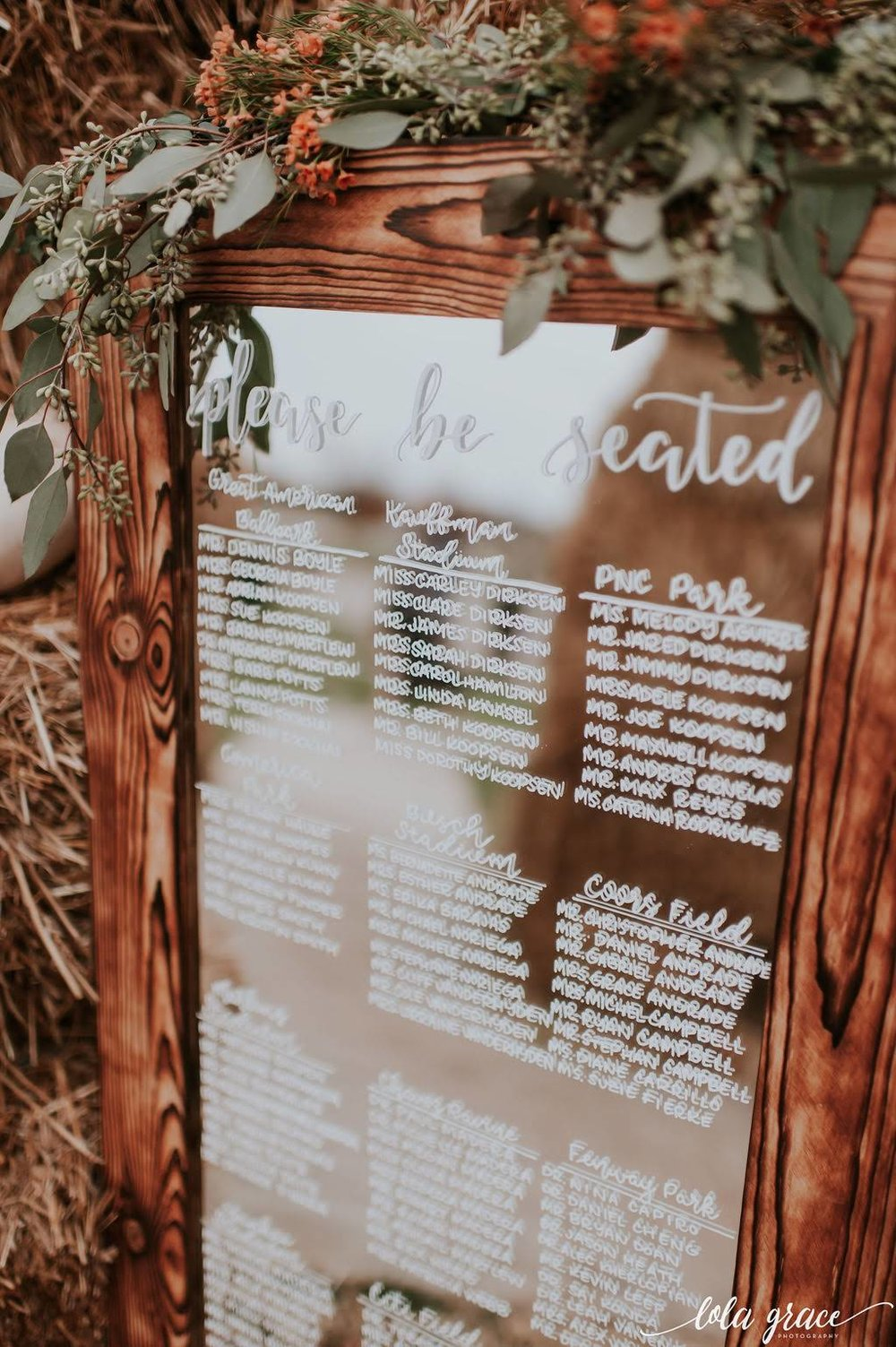 Paul and Michelle picked out this custom framed mirror for  Mitten Script by Marah  to create their seating chart then use in their home after the wedding.