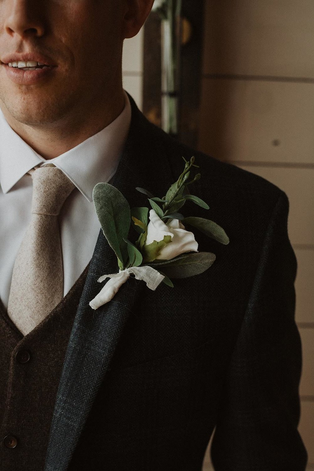 Jacob's plaid suit, brown vest, light brown tie and boutonniere is what texture dreams are made of!