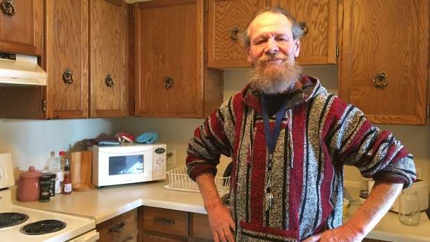 Bob Kastrukoff has had a few run-ins with police during his years on the streets in downtown Regina. Now he has a home and has welcomed officers inside for a visit. (Tory Gillis/CBC)