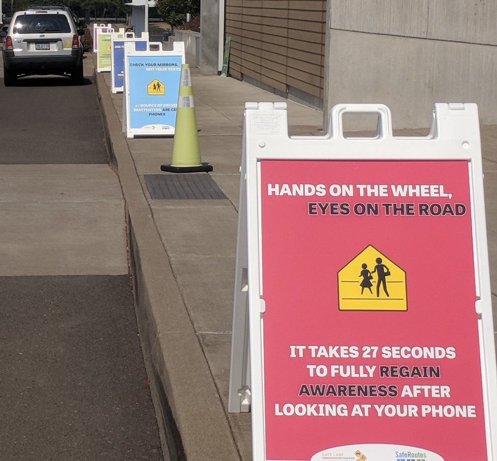 Distracted Driving Awareness Posters in front of a Lane County Elementary School.