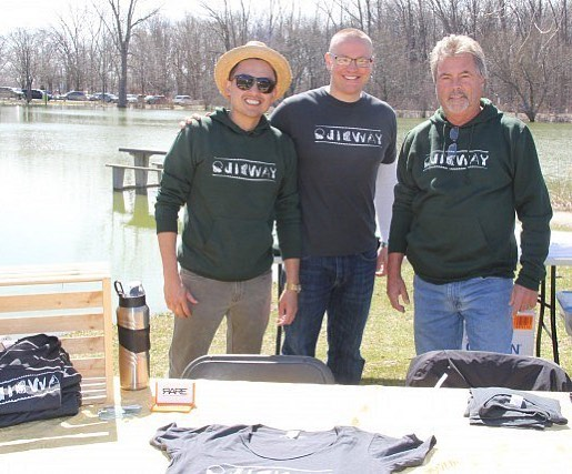 RARE Apparel co-owners Tam Nguyen and Scott Bisson pose with the Friends of Ojibway Prairie President Bill Roesel during the Earth Day celebrations at Malden Park on April 22, 2018.