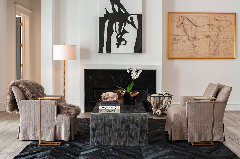Alternatively, this symmetrical setup brings more of a formal flair, giving focus to the artwork and fireplace.
