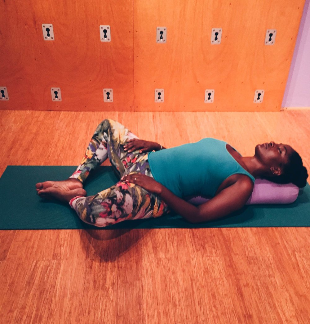 The pose can be done in seated, lying or on the yoga wall.