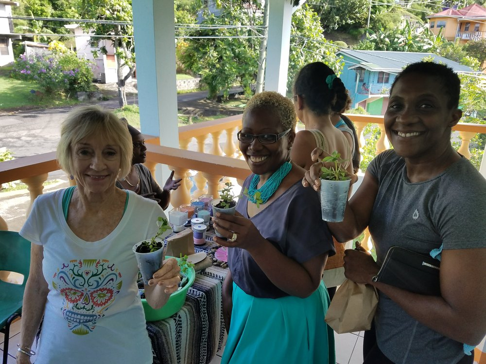 Xandra Fischer, Lucille Sylvester and Paula LaTouche show off their  Purslane  gifts from our resident farmer Ferron.