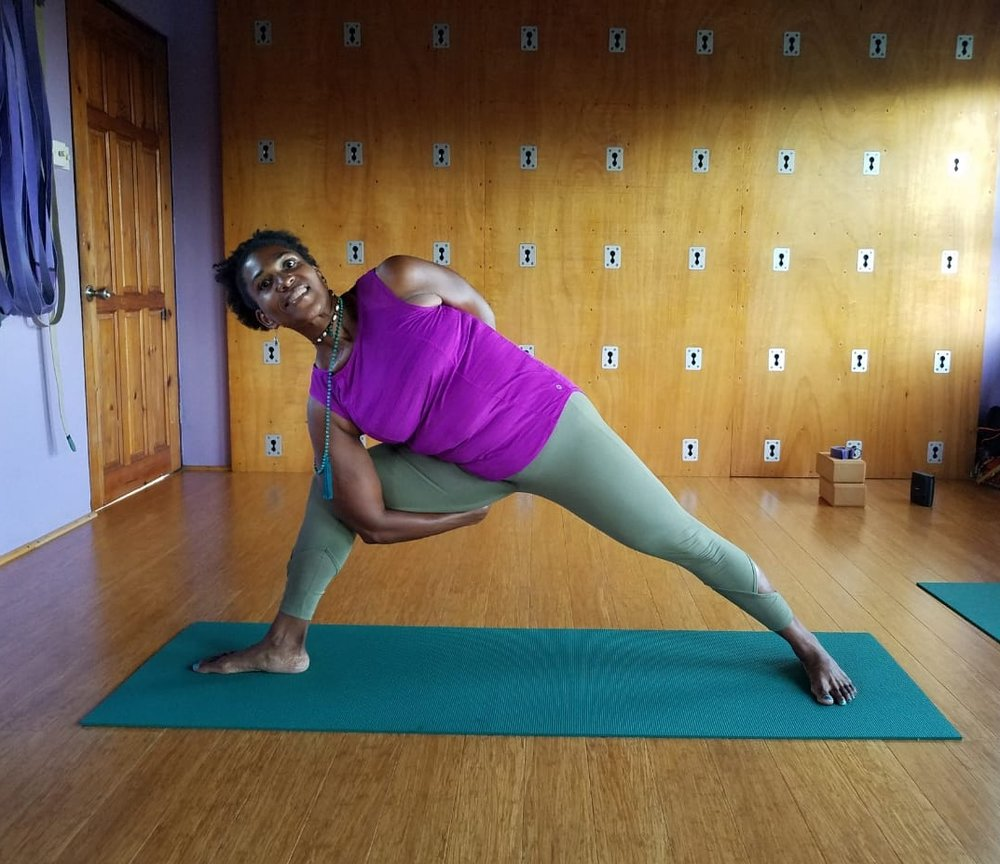 Guest yoga teacher, Marcia Cameron, in Bound Extended Side Angle Pose.
