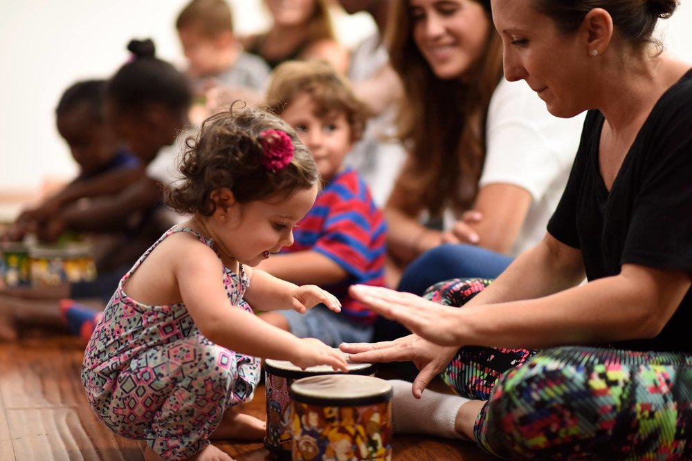 Zumbini class - girl playing drums.jpg