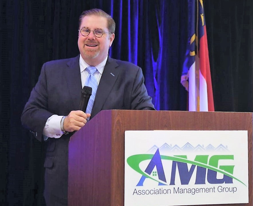 Paul Mengert, President of Association Management Group, Inc. (AMG) presents Community Leaders Seminar to community leaders.