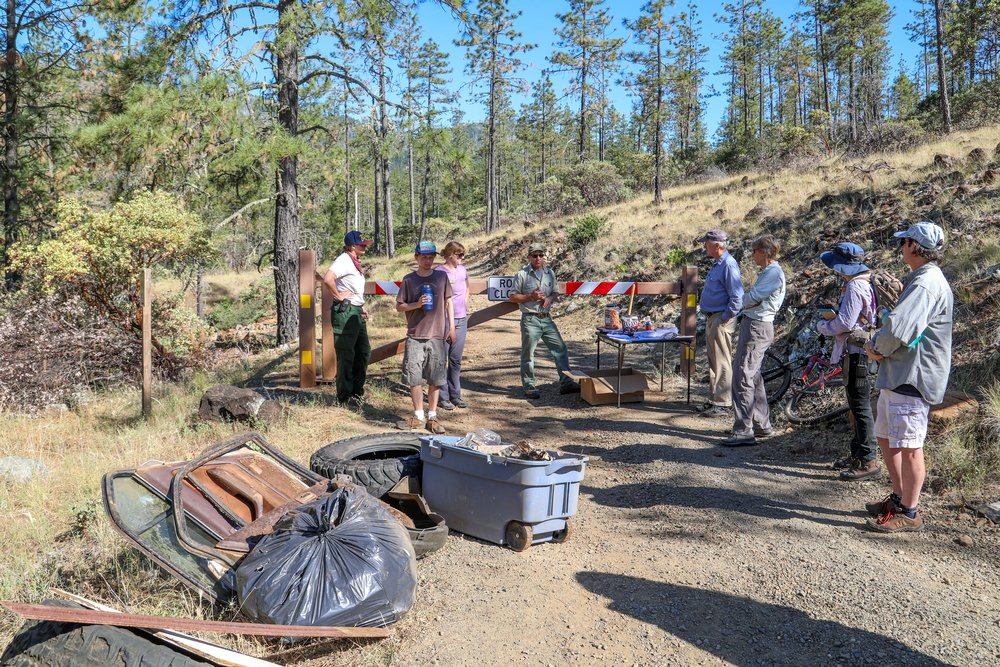 KS Wild Public Land Stewards and USFS employees cleaning up 8 Dollar Mountain Botanical Area and helping to prevent damage from future OHV use, David Christian Photo