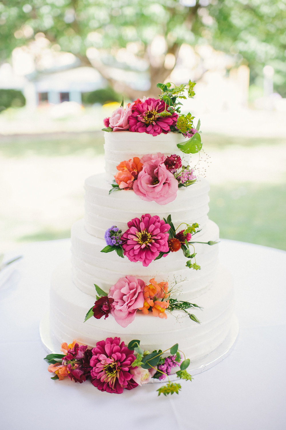Wedding cake flowers, courtesy of Ayres Photography
