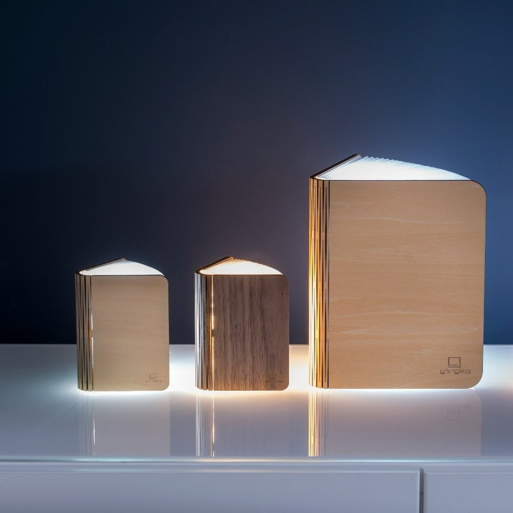 """Smart BookLight This smart booklight is a piece of design as well as a piece fo art. When closed with a maple or walnut cover and opens up to emit a beautiful ambient light through the """"pages"""". £36"""