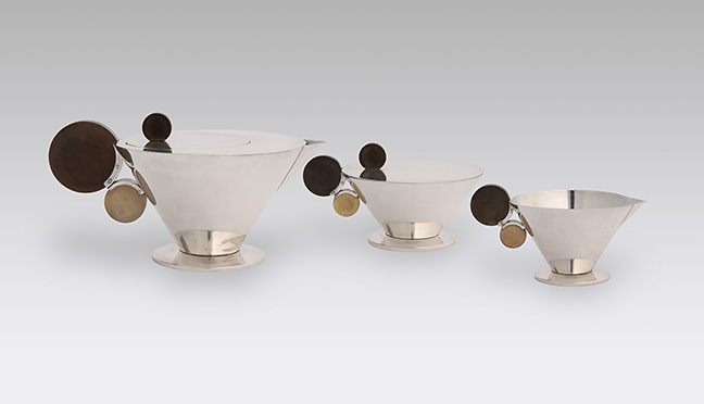 Margarete Heymann-Löbenstein, designer, German (Cologne, 1899-1990). Haël-Werkstätten, manufacturer, Germany (Marwitz, 1923-1934).  Tea Service , ca. 1930. Alpacca (silvered metal alloy) with synthetic resin. Purchase: the Charlotte and Perry Faeth Fund, 2005.26.1-3.