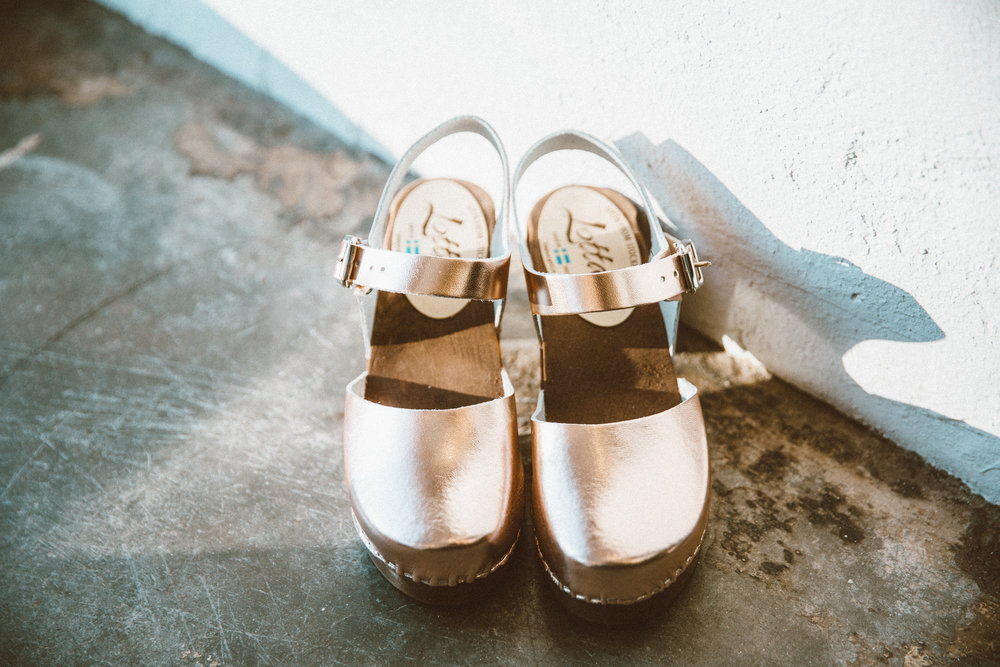 Rose gold clogs from We Are Sincerely Yours.
