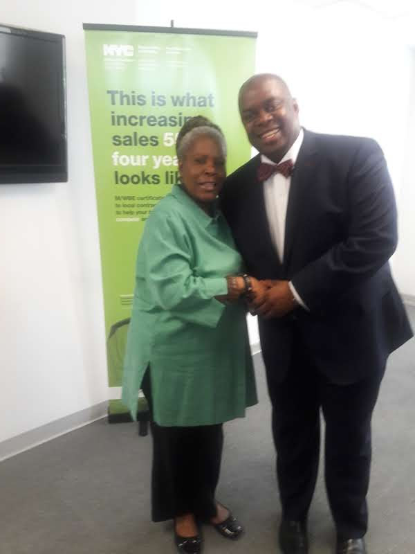 New York City Deputy Mayor Richard Buery greets Jean at New York City Business Solutions