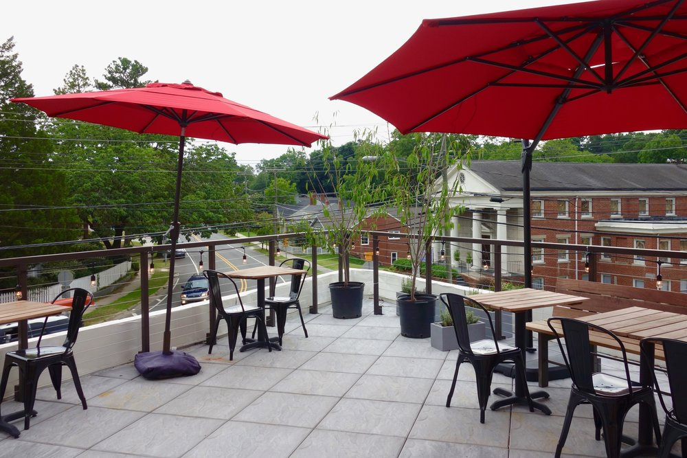 The Rooftop overlooks the historic Lakewood district of Durham. The space comes with pre-installed outdoor lighting, in-house furniture and umbrellas.