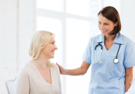 Bladder-pain-syndrome-or-interstitial-cystitis-expertise-nurse-with-happy-female-patient