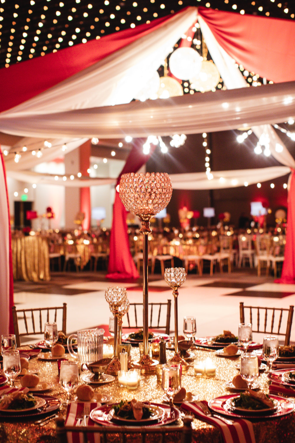 Total Events Dance Floor with Cabana at the Albany Capital Center - Featuring linens from The Collection, centerpieces, charger plates, and gold chiavari chairs.