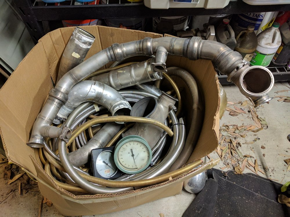Boxes and boxes of gauges, gears, and metallic tubing