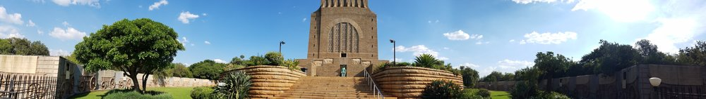 This massive  granite  structure is prominently located on a hilltop, and was raised to commemorate the  Voortrekkers  who left the Cape Colony between 1835 and 1854.