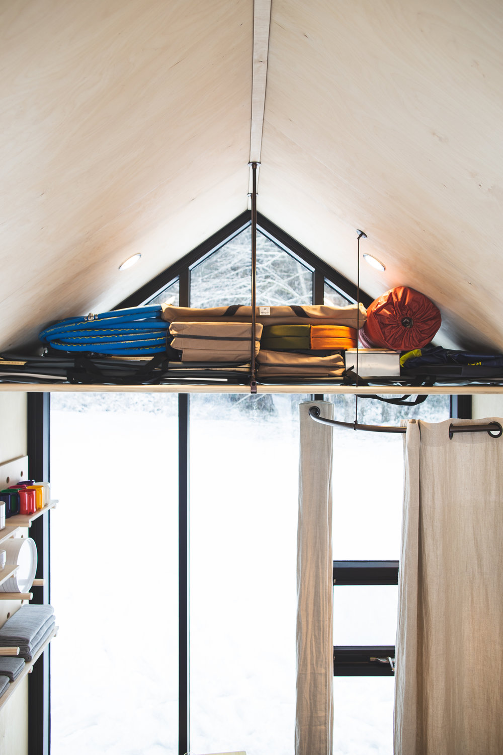 Stephen built the loft himself to hold his camping gear.