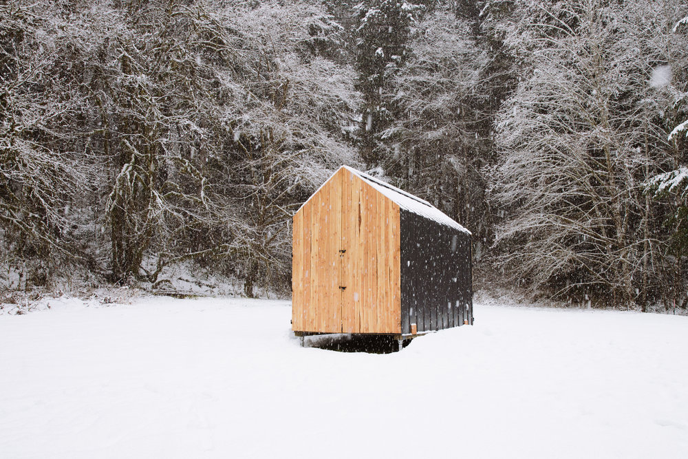 The Mono with barn doors shut against the snow.