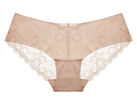 Image description: A flat-lay product photo of seamless beige underwear that has an entirely lace back.