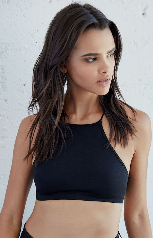 This  sporty high-neck bralette  is pretty fucking sexy in a too-cool-for-school '90s music video babe kind of way.   image description: A model with light brown skin and long, slightly wavy brown hair wears a black high-neck crop top. They are looking to their left. Photo by Pacific Sunwear of California, LLC