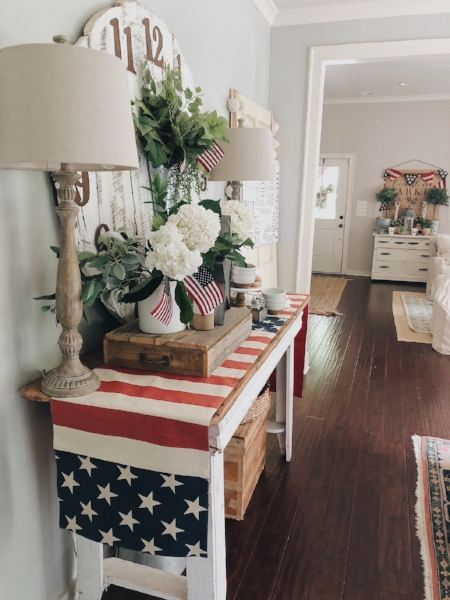 Patriotic table runner and flags make this space summer ready. The jute runner in entryway area is one of the most asked about pieces in this space, you can read more about where to find similiar ones  here .