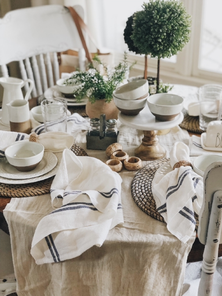 Our breakfast table holds a linen runner and napkins, combined with sea grass coasters and pops of marble and galvanized metal, creating a casual and cozy feel. To read more details on how I created this tablescape, you can head  here .