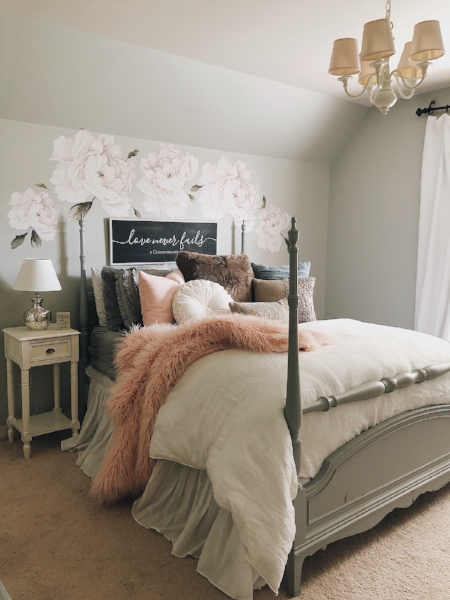 My middle daughter's bedroom is a mix of fuzzy, cotton and velvet pillows and blankets. For further reading on this accent wall we created, you can head  here .