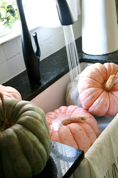 farmhouse sink full of pumpkins