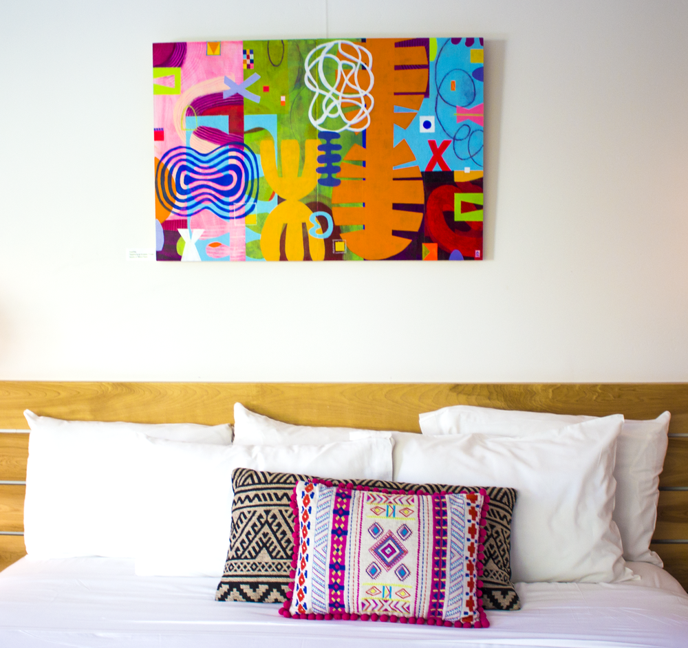 geometric painting above bed