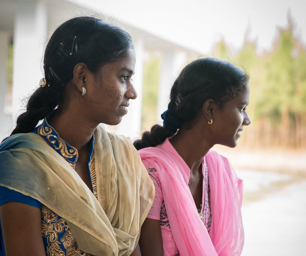 Pavani and Lavinia enjoying a visit back to the orphanage where they grew up