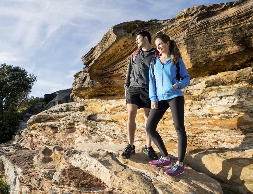 Couple standing on rocks in Sherpa 1000px.jpg