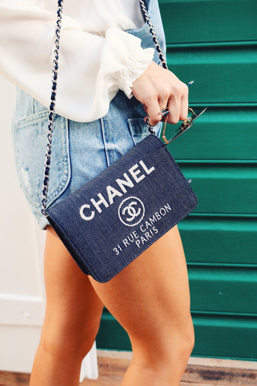 Victoria rocking her Chanel purse and denim romper in St. Barths